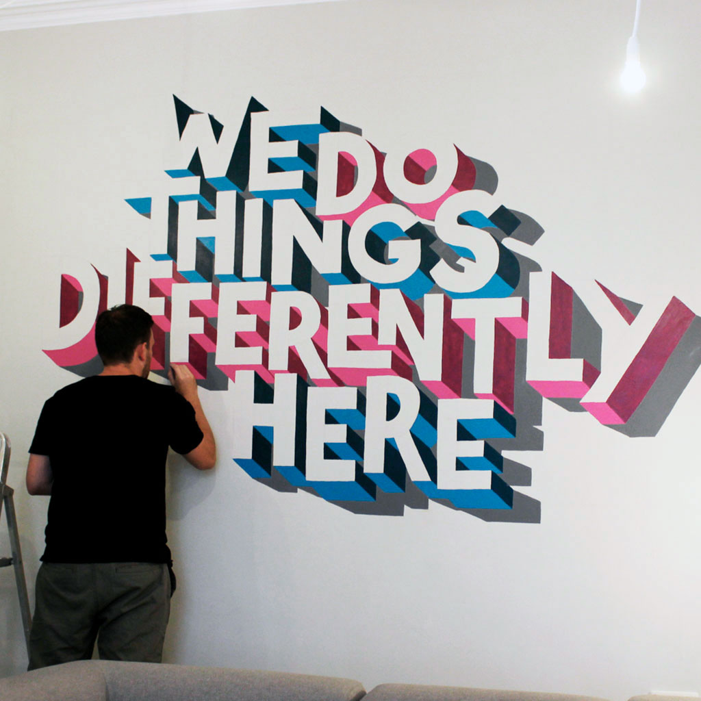 hand-painted 3D typography mural by Sketchbook Design. Wall mural created my Manchester artist