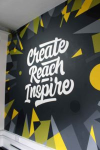 Create reach inspire wall mural at Radio.co in Manchester